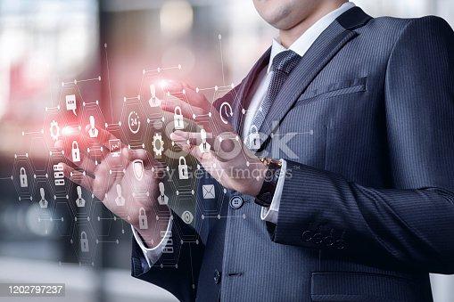 1197953545istockphoto Businessman working on virtual screen . 1202797237