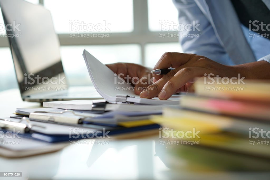Businessman working reading documents graph financial to job succes Analyze document plans royalty-free stock photo