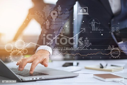 istock Businessman working using laptop computer with strategy and growth of business on screen 873806068