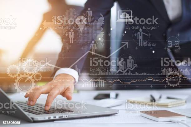 Businessman working using laptop computer with strategy and growth of picture id873806068?b=1&k=6&m=873806068&s=612x612&h=2abr5h9miupc78z3p5gtv681vscslklgmvmpe9 djmo=
