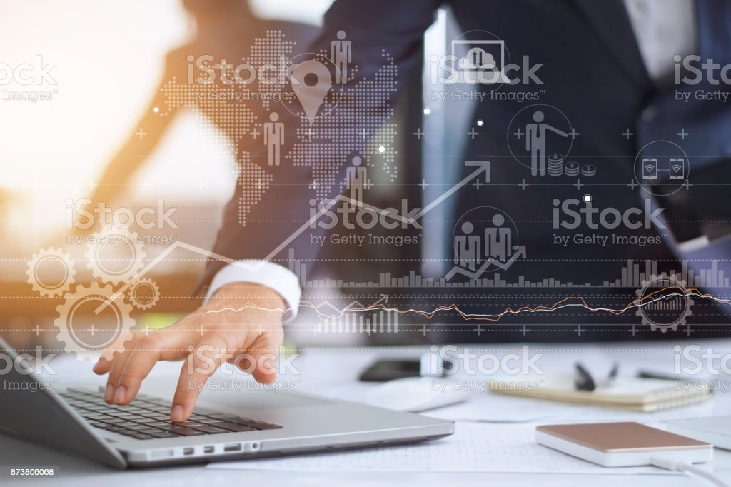 Businessman working using laptop computer with strategy and growth of business on screen stock photo