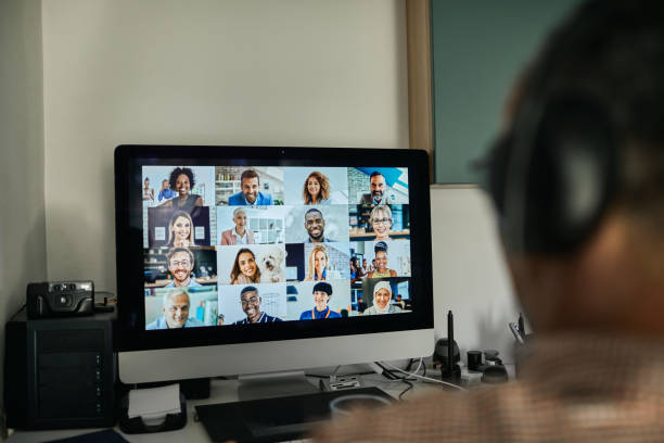 Businessman Working With Colleague Through Video Conferencing stock photo