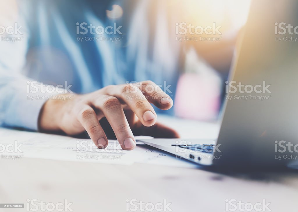 Businessman working with generic design notebook. Holding smartphone in hands stock photo