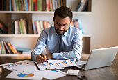 istock Businessman working with graph data at office 1178916040