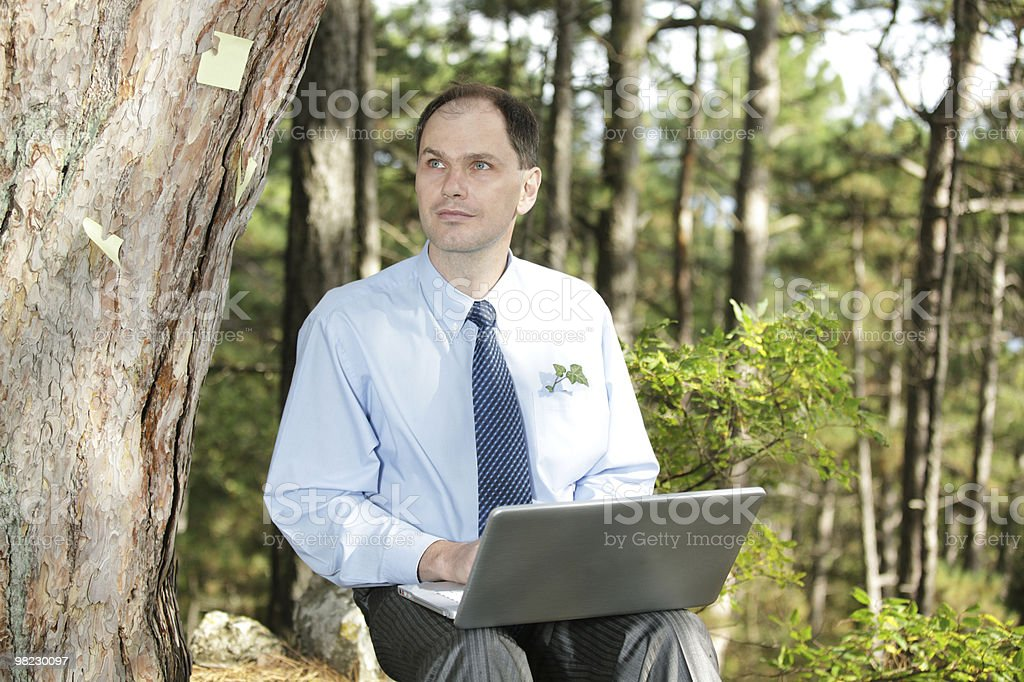 Businessman working with laptop outdoors royalty-free stock photo