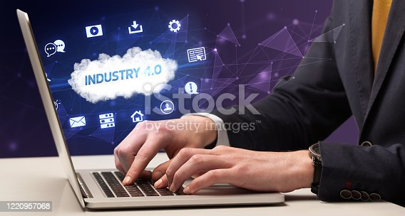 1160751010 istock photo Businessman working with laptop 1220957068