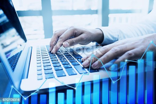 801895196 istock photo Businessman working with laptop with growing diagram graph. 670709316