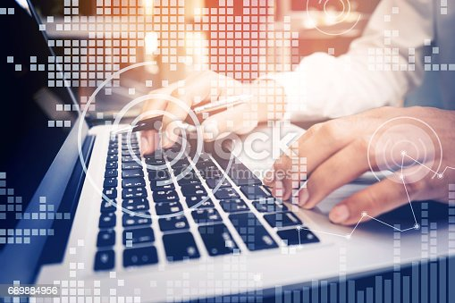 801895196istockphoto Businessman working with laptop,digital diagram 669884956