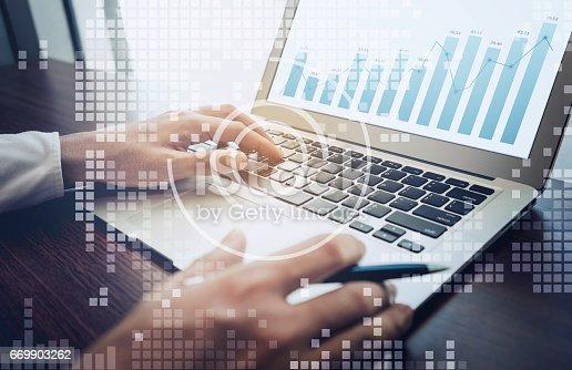 801895196istockphoto Businessman working with laptop,digital diagram 669903262