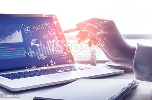 istock Businessman working with  modern laptop and icon.strategy concept 664599098