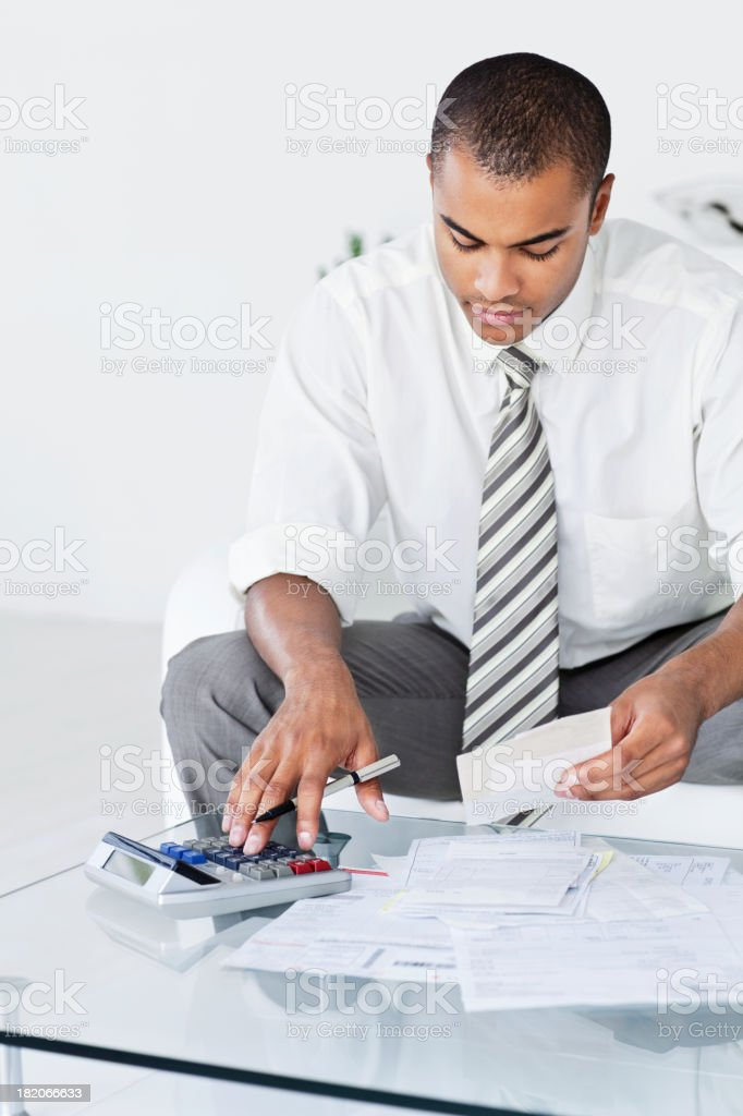 Businessman Working With Numbers stock photo