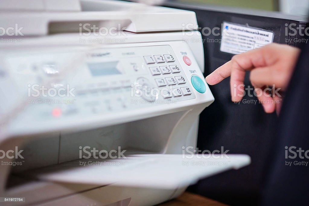 Businessman working with printer in the office ./Focus selection stock photo