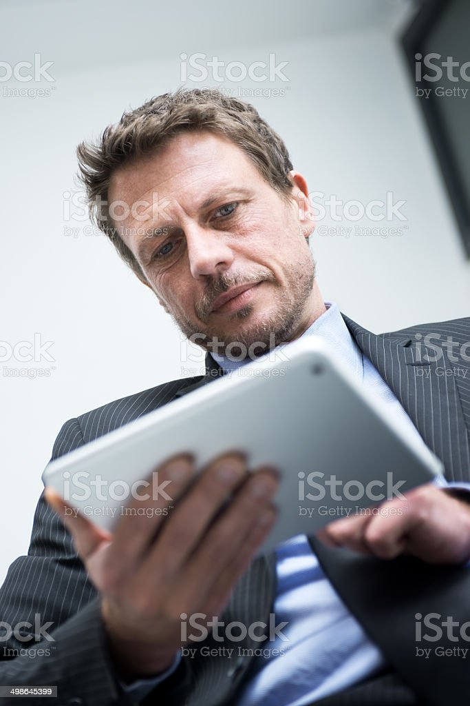 Businessman working with tablet stock photo