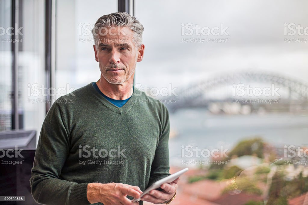 Businessman working with the digital tablet in office stock photo