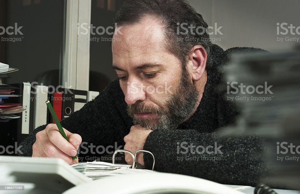 Businessman works at nighttime royalty-free stock photo