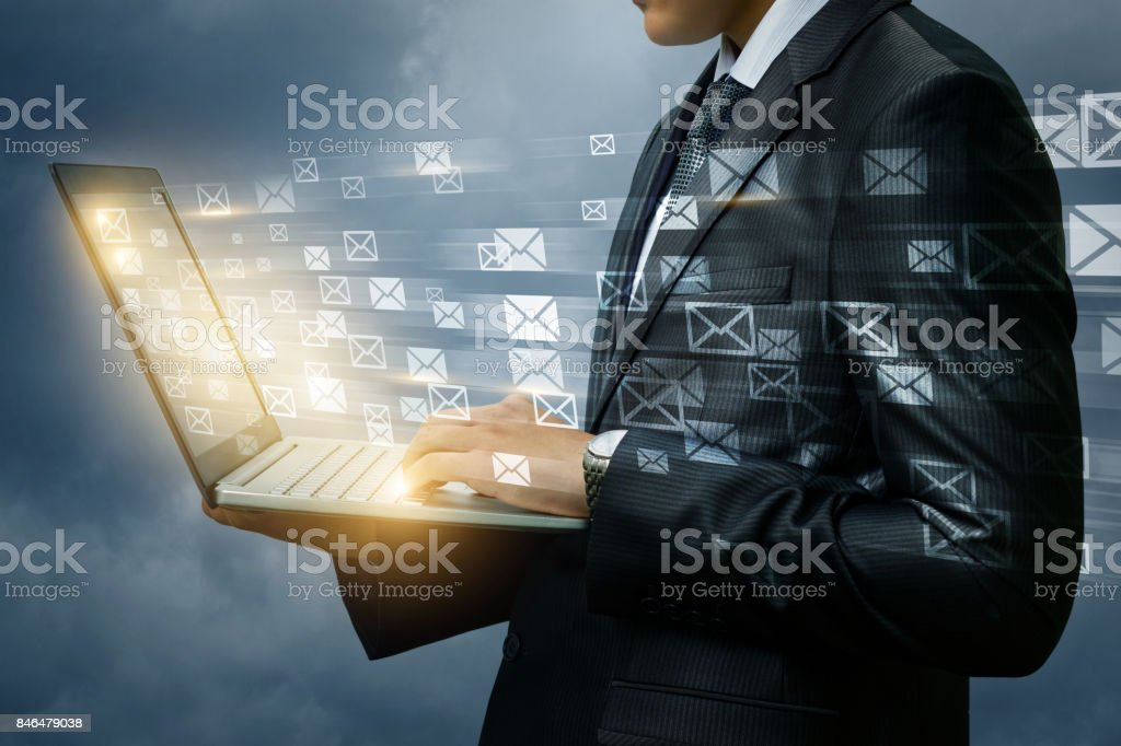 Businessman works with mail laptop. stock photo