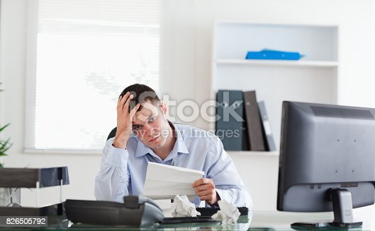 690496350istockphoto Businessman worried about invoice 826505792