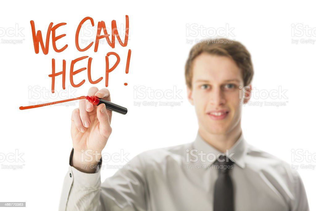 Businessman writes WE CAN HELP royalty-free stock photo