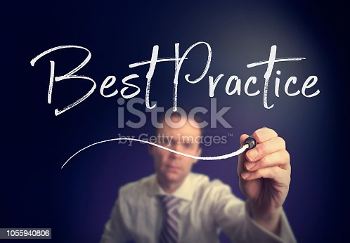 926292396 istock photo A businessman writing a Best Practice concept with a white pen 1055940806