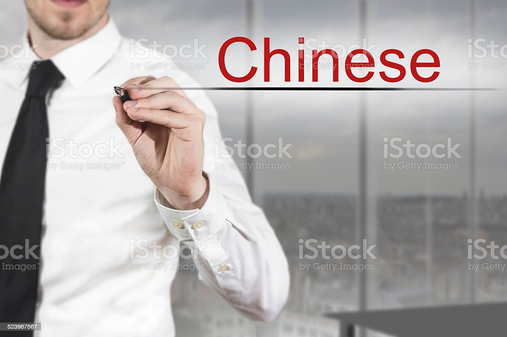 businessman writing chinese in the air language stock photo