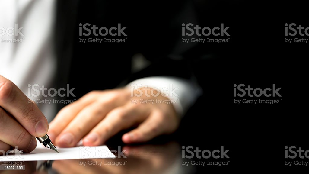 Businessman writing correspondence stock photo