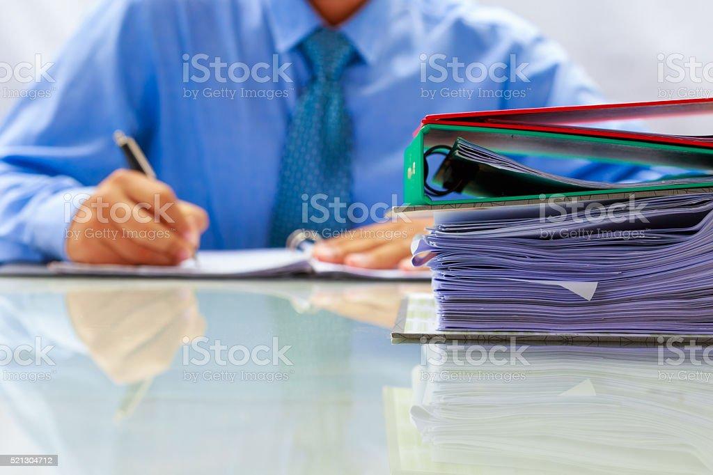 businessman writing document data stock photo