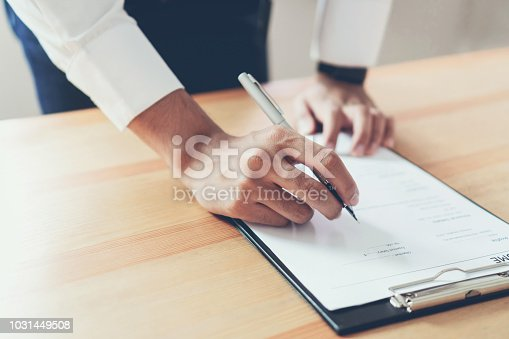 istock Businessman writing form submit resume employer to review job application. Concept presents ability for the company to agree with position of job. 1031449508
