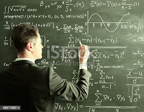 istock businessman writing formula 469758814