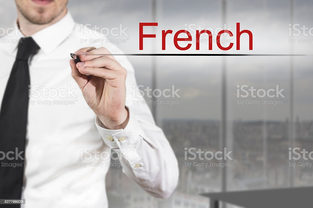 businessman writing french in the air stock photo
