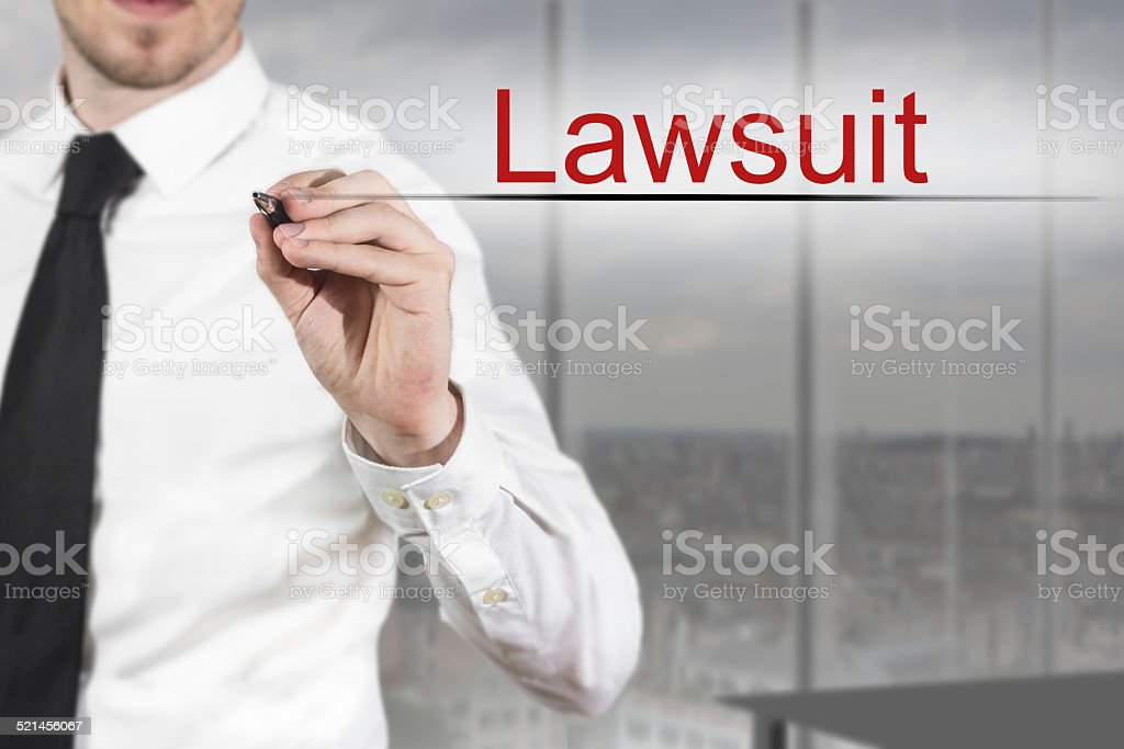 businessman writing in the air lawsuit stock photo