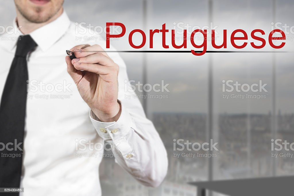 businessman writing in the air portuguese stock photo