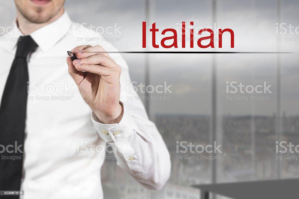 businessman writing italian in the air language stock photo