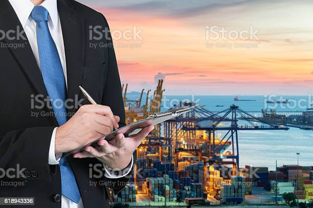 Businessman Writing Notebook For Trading And Logistics Stock Photo - Download Image Now