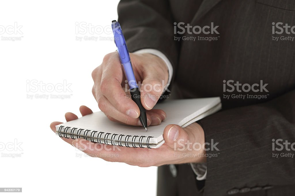 Businessman writing notes royalty-free stock photo