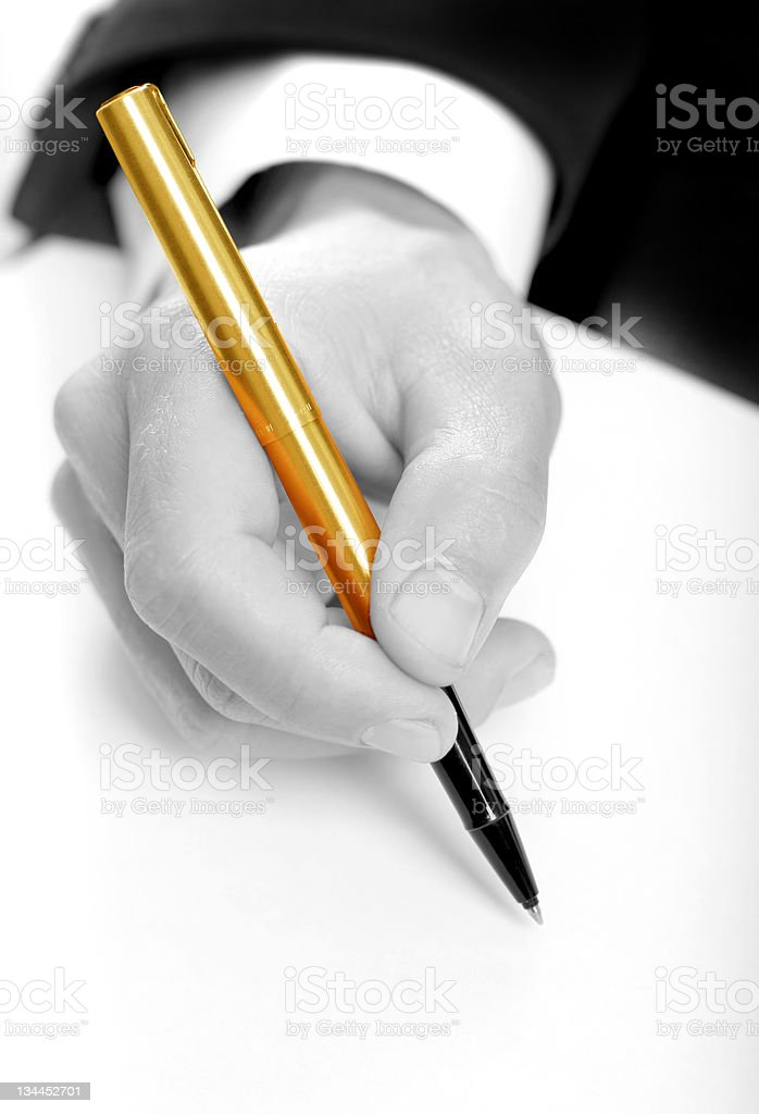 businessman writing on a form. B/W & Gold pen royalty-free stock photo