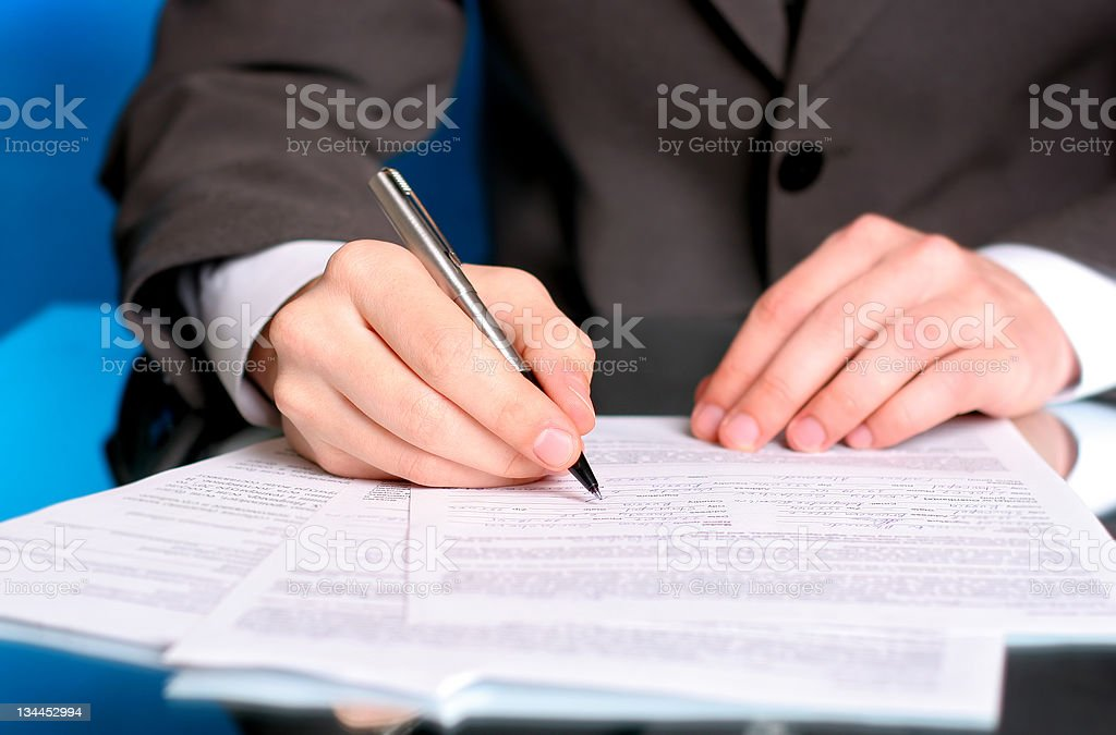 businessman writing on a form royalty-free stock photo