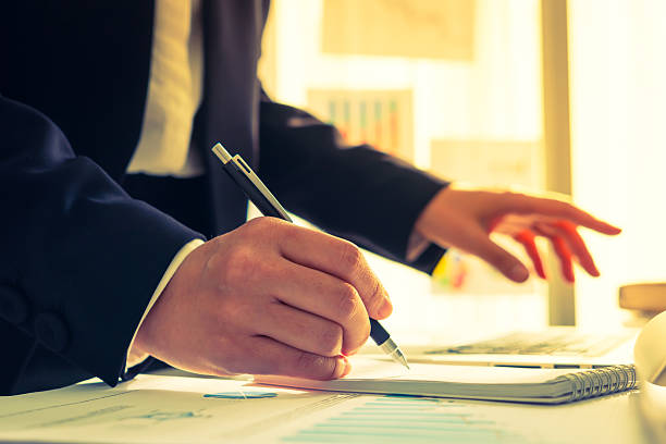 Businessman writing on a notebook stock photo