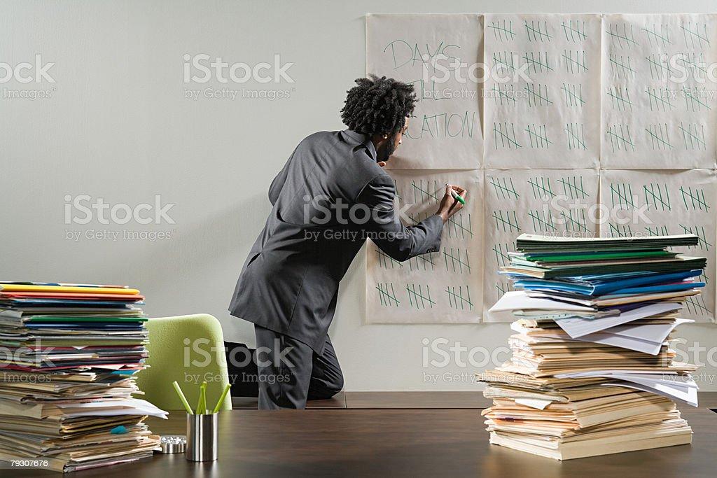 Businessman writing on a tally chart 免版稅 stock photo