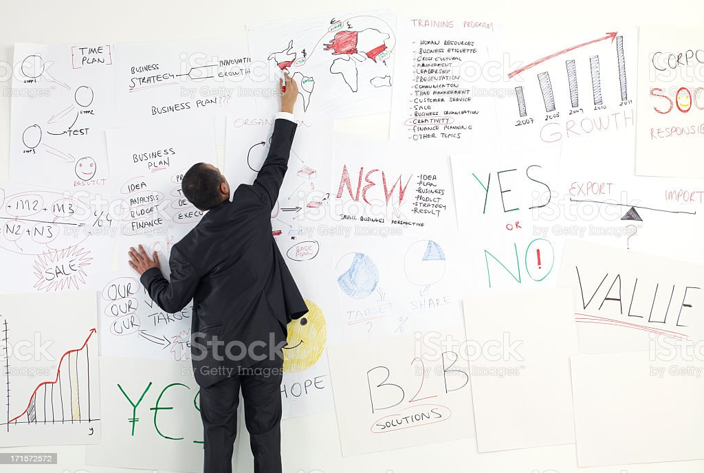 A businessman writing on a white board royalty-free stock photo