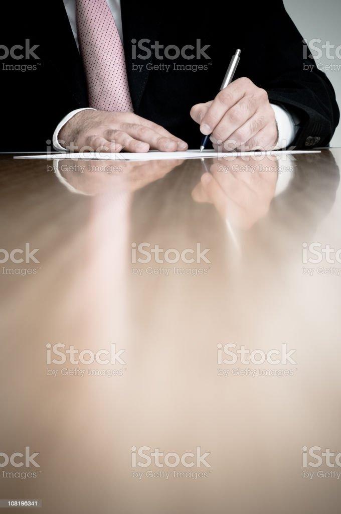 Businessman Writing on Document royalty-free stock photo