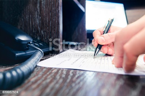659493026 istock photo Businessman writing on paper in office 639952524