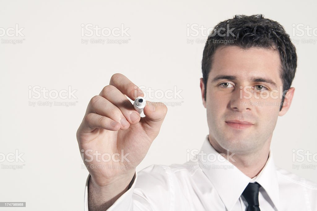 Businessman writing on screen stock photo