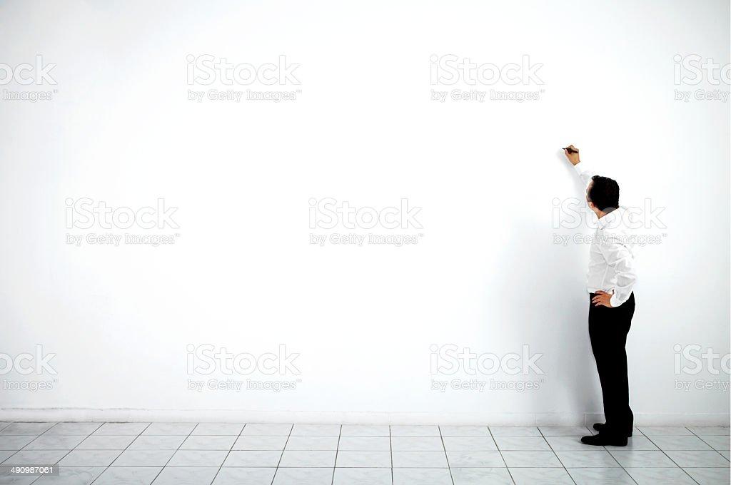 Businessman Writing On Wall stock photo