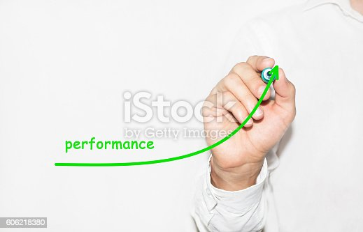 istock Businessman writing plan to increase company performance 606218380