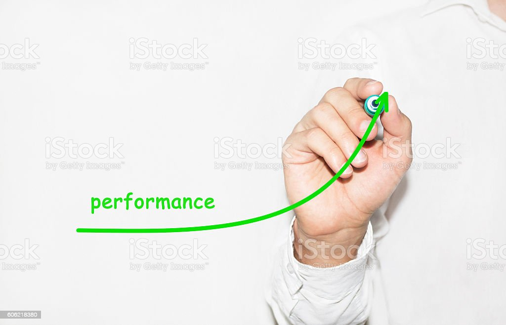 Businessman writing plan to increase company performance stock photo