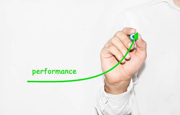 Businessman writing plan to increase company performance stock photo
