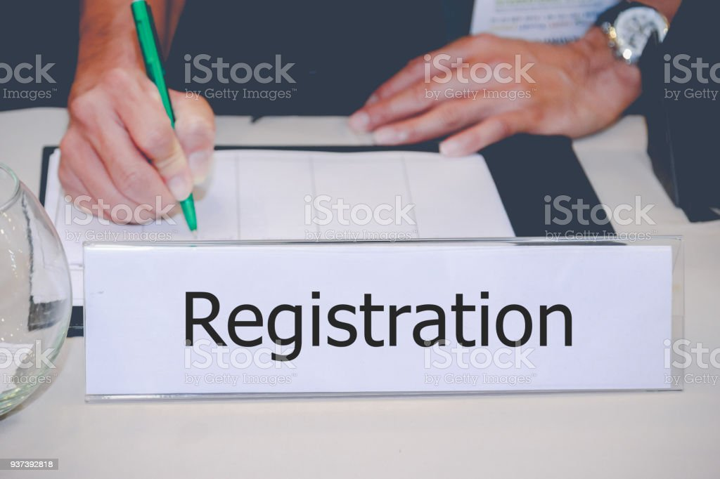 Businessman Writing register on the Table stock photo