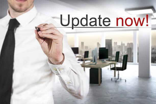 businessman writing update now in the air - iphone gratis stock-fotos und bilder