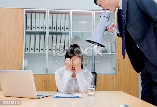 463813207 istock photo Businessman yelling at colleague through a bullhorn 593335112