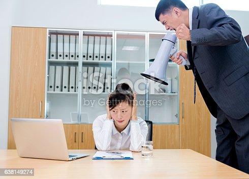463813207 istock photo Businessman yelling at colleague through a bullhorn 638149274